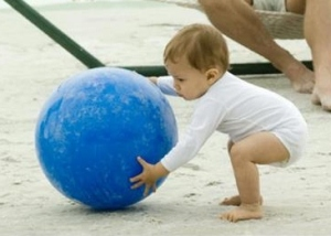 child picking up ball