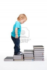 9096860-first-steps-of-education--kid-on-steps-made-of-books