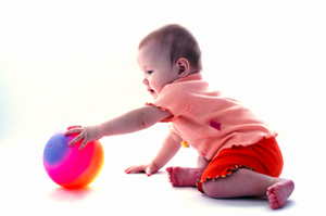 Baby_reaching-_for_ball-MED