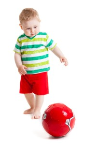 http://www.canstockphoto.com/little-boy-playing-with-a-ball-beautiful-14549721.html